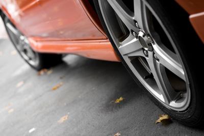 a closeup of the custom rims on a modern sports car with plenty of copyspace shallow depth of field HF9 J KCHo